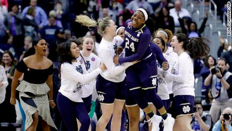 Notre Dame's Arike Ogunbowale (24) celebrates after making the game-winning basket to defeat Connecticut in overtime in the semifinals of the women's NCAA Final Four college basketball tournament on Friday.