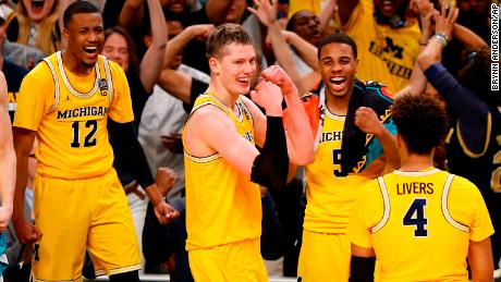 Michigan's Moritz Wagner, second from left, celebrates with his teammates during the second half in the semifinals of the Final Four NCAA college basketball tournament against Loyola-Chicago, Saturday, March 31, 2018, in San Antonio. (AP Photo/Brynn Anderson)