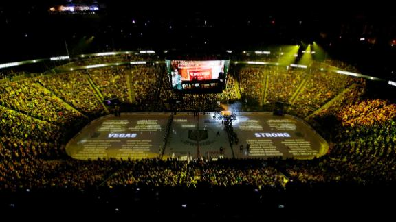 The names of people killed during the mass shooting in Las Vegas last year are projected on the ice during a ceremony before an NHL hockey game between the Vegas Golden Knights and the San Jose Sharks on Saturday in Las Vegas.