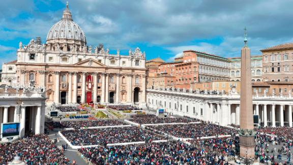 Thousands of people attend Easter Mass at St Peter's Square.