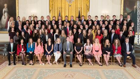 President Donald J. Trump poses for photos with the 2018 White House Spring intern class in the East Room at the White House, Monday, March 26, 2018, in Washington, D.C.