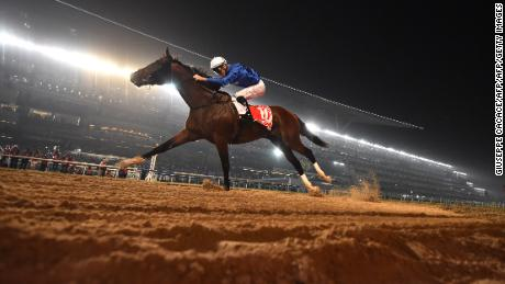Jockey Christophe Soumillon rides Thunder Snow across the finish line to win the Dubai World Cup horse race at the Dubai World Cup in the Meydan Racecourse on March 31, 2018 in Dubai. / AFP PHOTO / GIUSEPPE CACACE        (Photo credit should read GIUSEPPE CACACE/AFP/Getty Images)