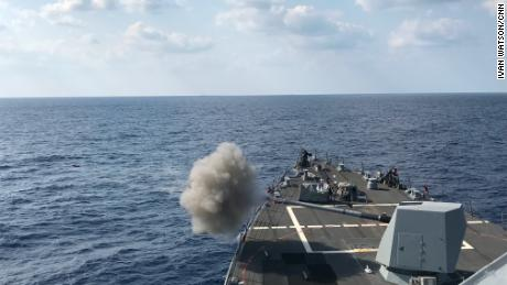 The USS Dewey fires its 5 inch gun during a training exercise in March 2018.