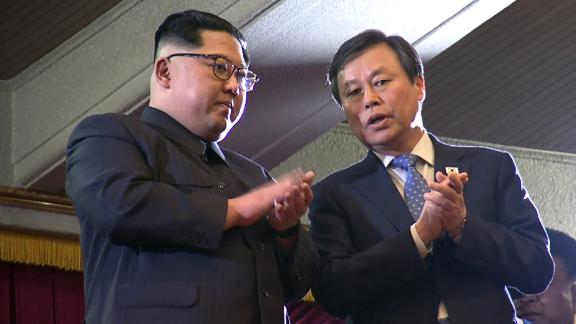 This picture captured from a video footage by Korea Pool reporters shows North Korean leader Kim Jong Un (L) and South Korea's Culture, Sports and Tourism Minister Do Jong-whan (R) during a rare concert by South Korean musicians at the 1,500-seat East Pyongyang Grand Theatre in Pyongyang on April 1, 2018. North Korean leader Kim Jong Un on April 1 attended the first concert in Pyongyang for over a decade by South Korean entertainers, including a K-pop girlband, the latest gesture of reconciliation before a rare inter-Korean summit.  / AFP PHOTO / KOREA POOL / - / South Korea OUT        (Photo credit should read -/AFP/Getty Images)