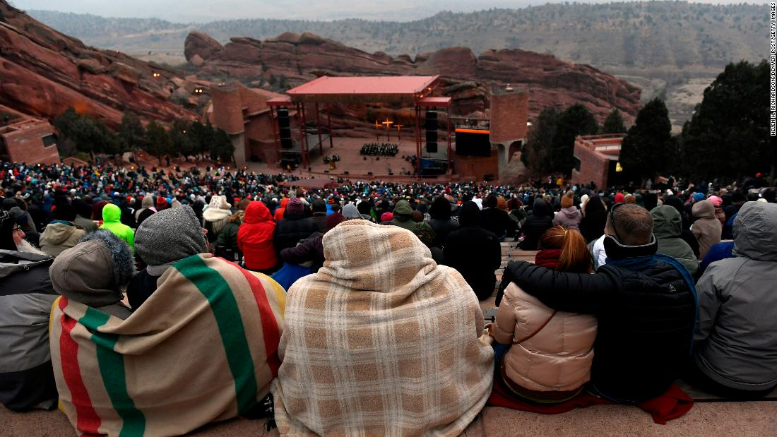 With predawn temperatures below freezing, people brought blankets, and dressed warmly for the 71st annual Easter Sunrise service at Red Rocks Amphitheatre on April 1 in Morrison, Colorado. The  annual service  is organized each year by the Colorado Council of Churches.