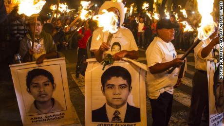A students of the Ayotzinapa school and parents of the 43 missing students take part in a protest in Guadalajara City on November 18, 2014.  A caravan of students and relatives of the missing students came to Jalisco State as part of its journey to the Mexican capital to end November 20. AFP PHOTO/Hector Guerrero        (Photo credit should read HECTOR GUERRERO/AFP/Getty Images)