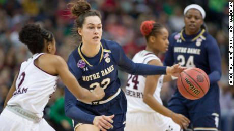 Notre Dame Fighting Irish forward Kathryn Westbeld (33) drives past Mississippi State Lady Bulldogs guard Morgan William (2) in the National Championship game.