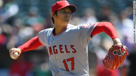 OAKLAND, CA - APRIL 01:  Shohei Ohtani #17 of the Los Angeles Angels of Anaheim pitches in the bottom of the first inning of his Major League pitching debut against the Oakland Athletics at Oakland Alameda Coliseum on April 1, 2018 in Oakland, California.  (Photo by Thearon W. Henderson/Getty Images)