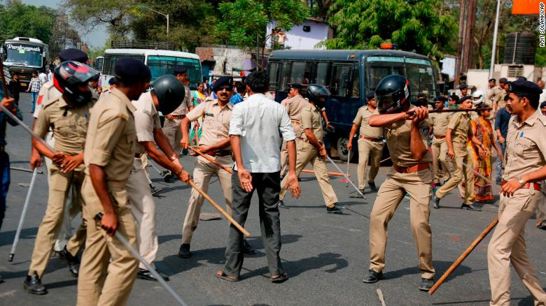 Police beat a lower-caste Dalit man in Ahmadabad on Monday as demonstrations spread.