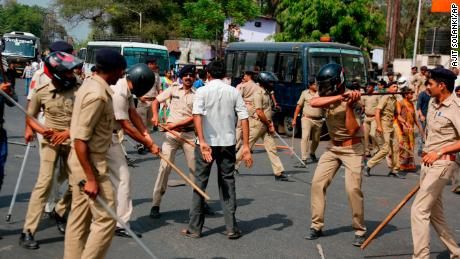 Police beat a protester in Ahmadabad during demonstrations Monday.