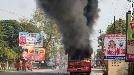 A public bus burns in Muzaffarnagar, Uttar Pradesh on Monday.