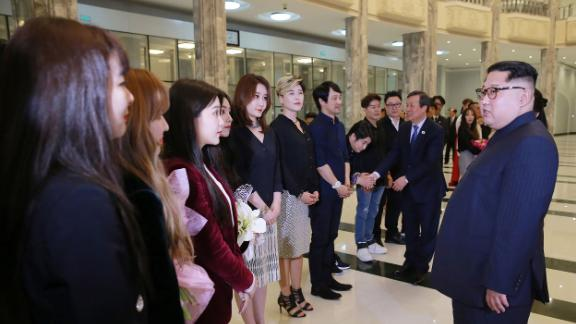 North Korean leader Kim Jong-Un speaks to South Korean musicians after the concert, in this photo released from North Korea's official Korean Central News Agency (KCNA).