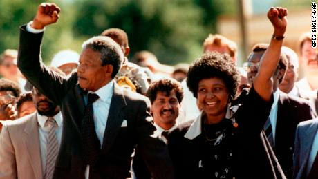 Nelson and Winnie Mandela raise fists to supporters after his release from jail in February 1990.