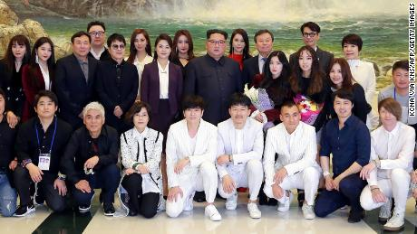 North Korean leader Kim Jong Un and his wife Ri Sol Ju posing with South Korea's Culture, Sports and Tourism Minister Do Jong-whan and South Korean musicians, April 1.