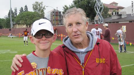 Twelve-year old Jake Olson with then-USC football coach Pete Carroll.
