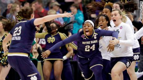 Notre Dame's Arike Ogunbowale (24) is congratulated by teammate Jessica Shepard (23) after sinking a 3-point basket to defeat Mississippi State 61-58 in the final of the women's NCAA Final Four college basketball tournament, Sunday, April 1, 2018, in Columbus, Ohio. (AP Photo/Tony Dejak)