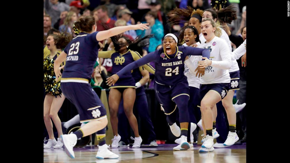 "Notre Dame's Arike Ogunbowale (No. 24) celebrates with her teammates after <a href=""https://www.cnn.com/2018/04/01/sport/ncaa-womens-basketball-championship/index.html"" target=""_blank"">hitting a 3-pointer</a> to defeat Mississippi State 61-58 and win the national championship on Sunday, April 1. Ogunbowale also hit <a href=""http://bleacherreport.com/articles/2767569-arike-ogunbowale-hits-game-winner-notre-dame-sinks-uconn-in-womens-tournament"" target=""_blank"">a game-winning shot</a> to defeat Connecticut in the semifinals."