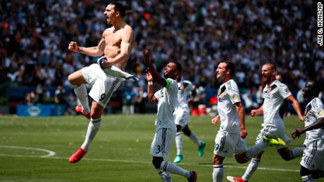 Los Angeles Galaxy's Zlatan Ibrahimovic, left, of Sweden, celebrates his goal during the second half of an MLS soccer match against the Los Angeles FC Saturday, March 31, 2018, in Carson, Calif. The Galaxy won 4-3. (AP Photo/Jae C. Hong)