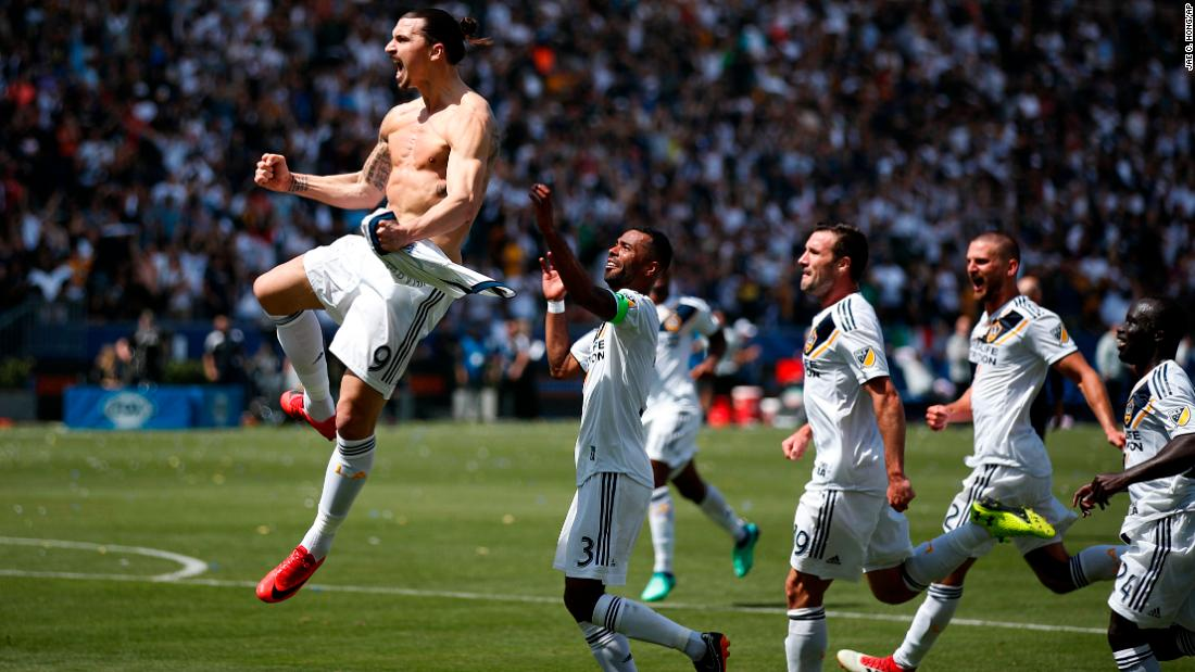 "Zlatan Ibrahimovic is chased by his Los Angeles Galaxy teammates as they celebrate <a href=""http://bleacherreport.com/articles/2767660-zlatan-ibrahimovic-scores-brace-in-20-minutes-to-steal-win-in-mls-debut"" target=""_blank"">his spectacular first goal</a> against Los Angeles FC on Saturday, March 31. The Swedish superstar was making his Major League Soccer debut, and he scored twice to help the Galaxy come back from three goals down to win 4-3."