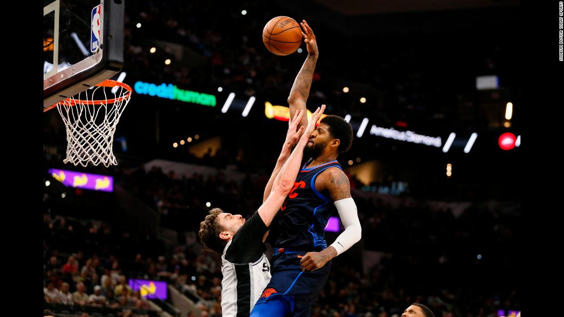 Oklahoma City forward Paul George is defended by San Antonio's Pau Gasol during an NBA game on Thursday, March 29.