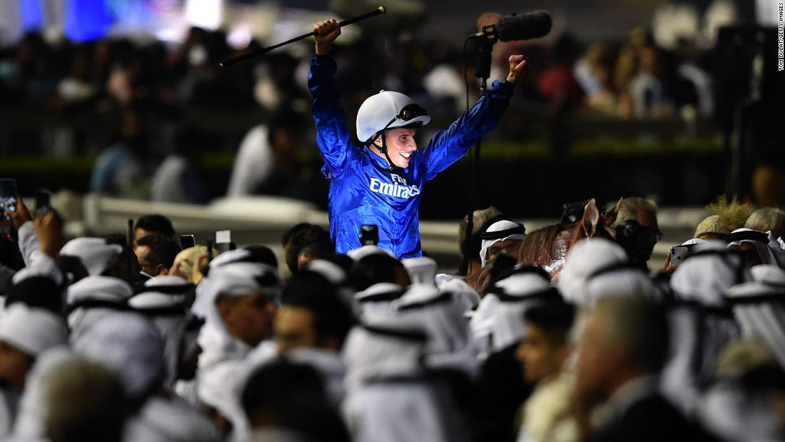 Jockey William Buick celebrates after riding Hawkbill to win a race at the Dubai World Cup on Saturday, March 31.