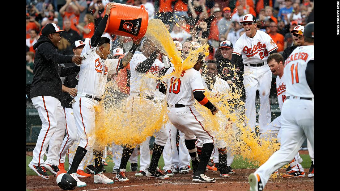 Adam Jones is doused by his Baltimore teammates after hitting a walkoff home run in the 11th inning on Thursday, March 29. The Orioles defeated Minnesota 3-2.