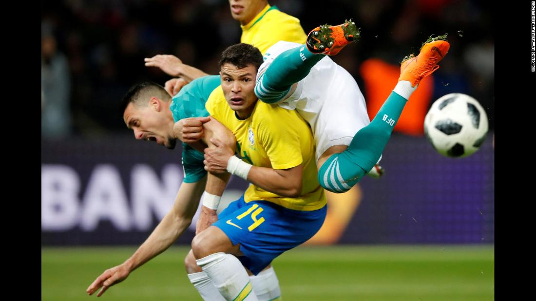Germany's Sandro Wagner, right, collides with Brazil's Thiago Silva during a friendly match in Berlin on Tuesday, March 27.