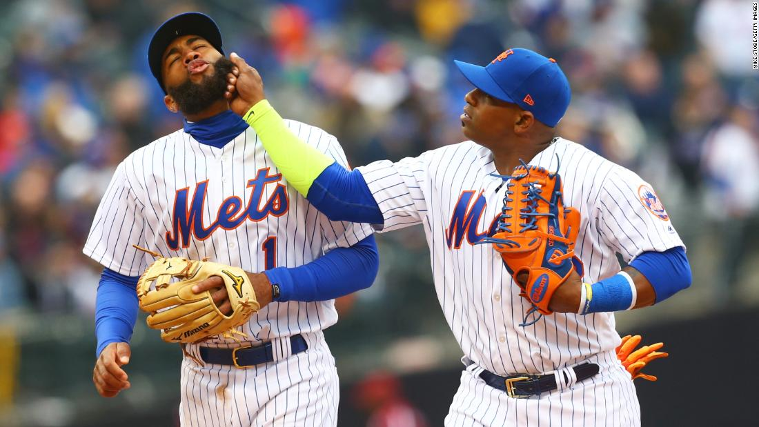 New York Mets teammates Amed Rosario, left, and Yoenis Cespedes joke around during their Opening Day game against St. Louis on Thursday, March 29.