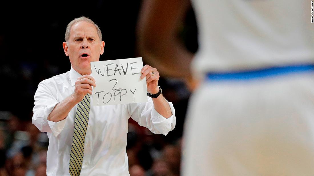 Michigan's John Beilein uses visual aids to coach his team in the first half.