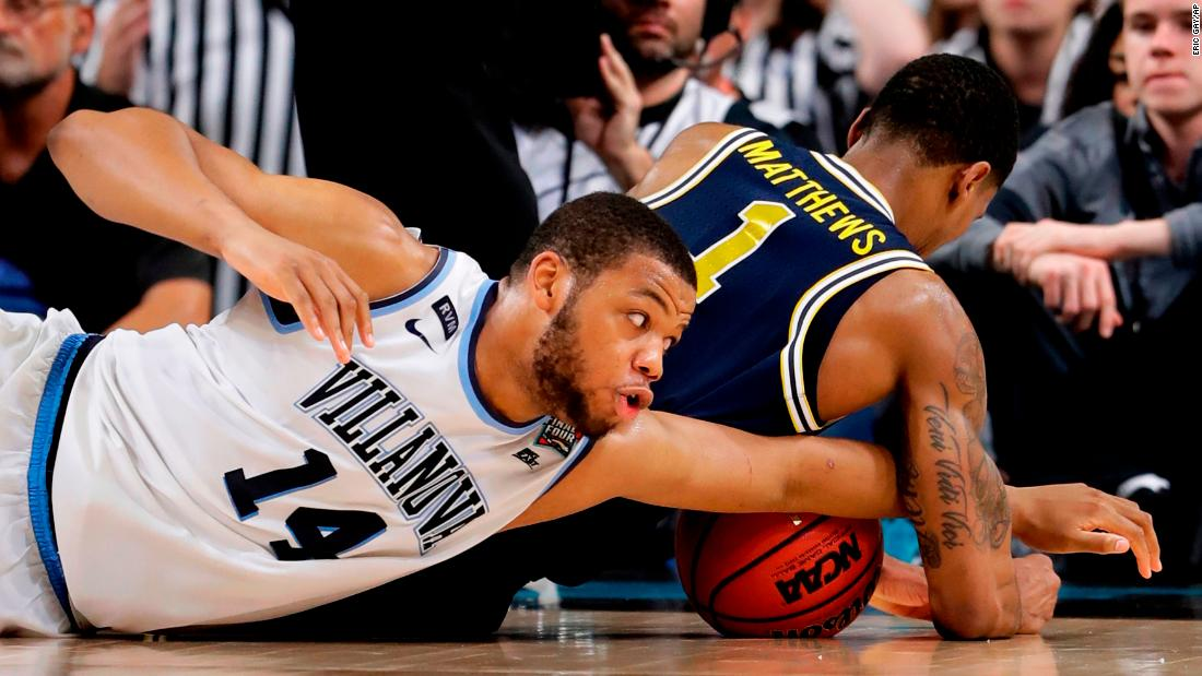 Villanova forward Omari Spellman, left, battles for a loose ball with Michigan's Charles Matthews during the second half. The game was played at the Alamodome in San Antonio.