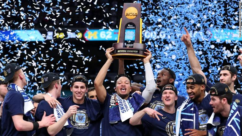 SAN ANTONIO, TX - APRIL 02:  Jalen Brunson #1 of the Villanova Wildcats raises the trophy and celebrates with his teammates after defeating the Michigan Wolverines during the 2018 NCAA Men's Final Four National Championship game at the Alamodome on April 2, 2018 in San Antonio, Texas.  Villanova defeated Michigan 79-62.  (Photo by Tom Pennington/Getty Images)