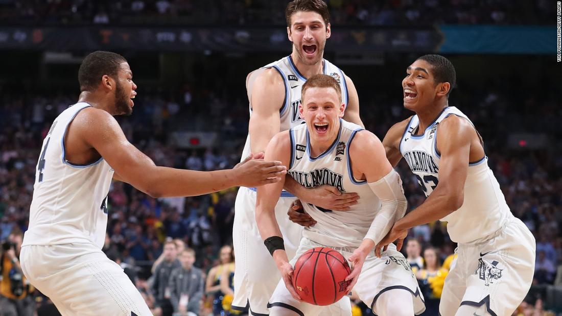 "Donte DiVincenzo is mobbed by his Villanova teammates at the end of the national championship game on Monday, April 2. DiVincenzo came off the bench to score a game-high 31 points as <a href=""http://www.cnn.com/2018/04/02/sport/2018-ncaa-mens-basketball-championship/index.html"" target=""_blank"">the Wildcats blew out Michigan 79-62.</a> It is their second title in three years."