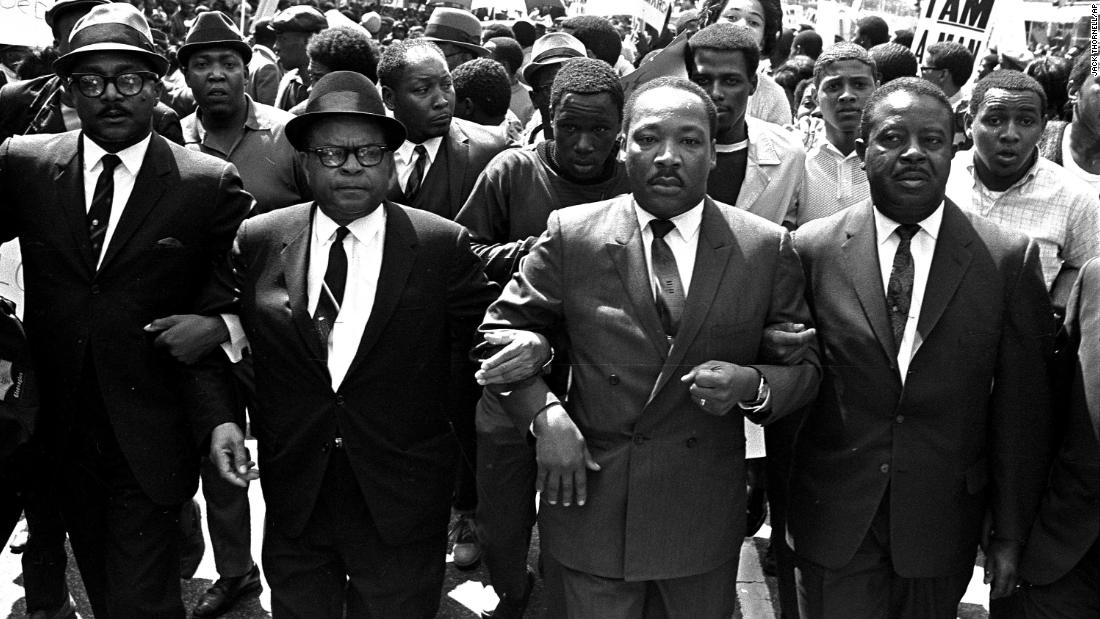 The Rev. Ralph Abernathy, right, and Bishop Julian Smith, left, flank Dr. Martin Luther King, Jr., during a civil rights march in Memphis on March 28, 1968 -- one week before King was shot.