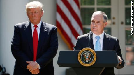 President Donald Trump listens as EPA Administrator Scott Pruitt speaks about the U.S. role in the Paris climate change accord, Thursday, June 1, 2017, in the Rose Garden of the White House in Washington. (AP Photo/Pablo Martinez Monsivais)
