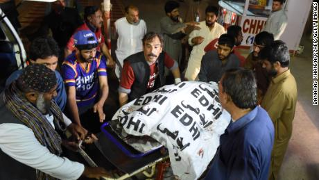 Pakistani volunteers move the body of a Christian resident killed in an attack by gunmen to a hospital in Quetta on April 2, 2018.