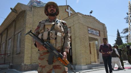 A Pakistani security personnel stands guard during a Easter mass outside a Church in Quetta on April 1, 2018.
