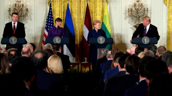 President Donald Trump speaks during a news conference with, from left, Latvian President Raimonds Vejonis, Estonian President Kersti Kaljulaid, and Lithuanian President Dalia Grybauskaite in the East Room of the White House, Tuesday, April 3, 2018, in Washington. (AP Photo/Evan Vucci)