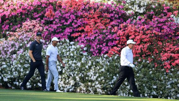 Woods (second left) joined Phil Mickelson (right) and Belgium's Thomas Pieters for a practice round Tuesday.