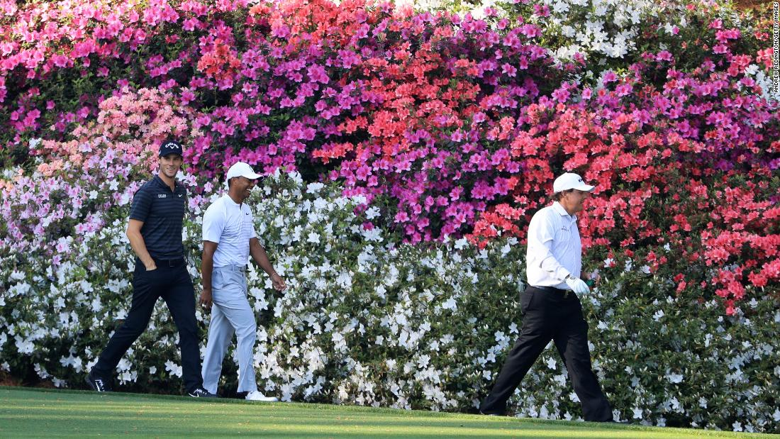 Woods was touted as one of the favorites after impressing in his early-season events. He also set tongues wagging by playing a practice round with old rival Phil Mickelson (right).