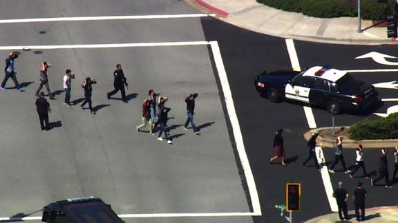 Overhead video from CNN affiliate KGO showed a heavy police presence. People gathered outside, and one by one they were were frisked and patted down by officers. Several roadways near the building were closed to traffic.