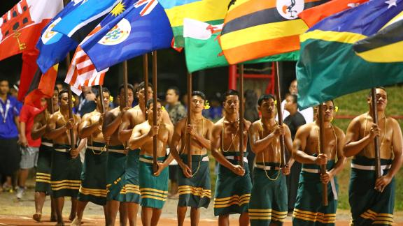 APIA, SAMOA - SEPTEMBER 11:  Participants hold flags aloft during the Closing Ceremony at the Apia Park Sports Complex on day five of the Samoa 2015 Commonwealth Youth Games on September 11, 2015 in Apia, Samoa.  (Photo by Scott Barbour/Getty Images)