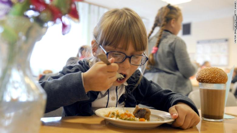Children enjoy lunch, including meat and vegetables, at the Kolno village school in Belarus, a landlocked country in Eastern Europe. Experts say that eating well-balanced meals can benefit a child's cognitive functioning and performance in school.