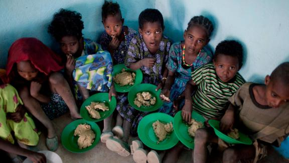 Children receive a hot meal provided by the humanitarian organization World Food Programme at a rural school in the city of Adama, also called Nazret or Nazareth, in central Ethiopia. Many of the students walk for an hour or two to school every morning, and in some cases, they attend school because of the free meals.