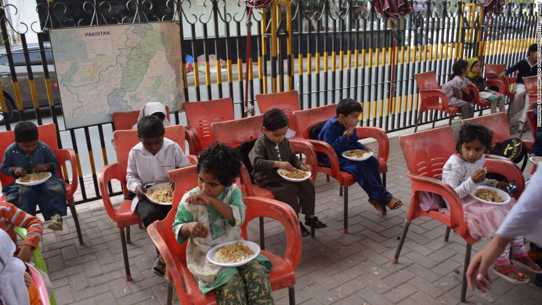 Lunch involves traditional dishes at the Karachi Footpath School in the province of Sindh in Pakistan. The school provides lunch for free to all students before they leave at 1 p.m.