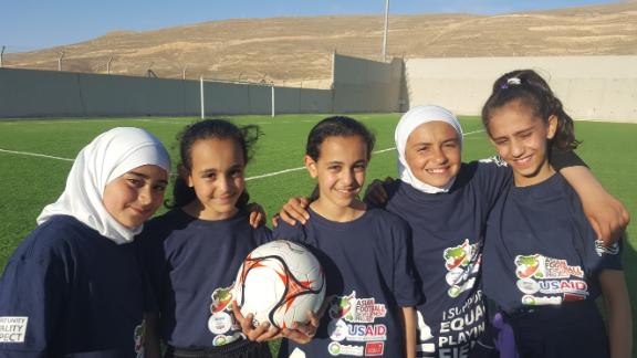 """Kids at football camp in Petra. None had ever played before and said playing that day made them """"so happy."""""""