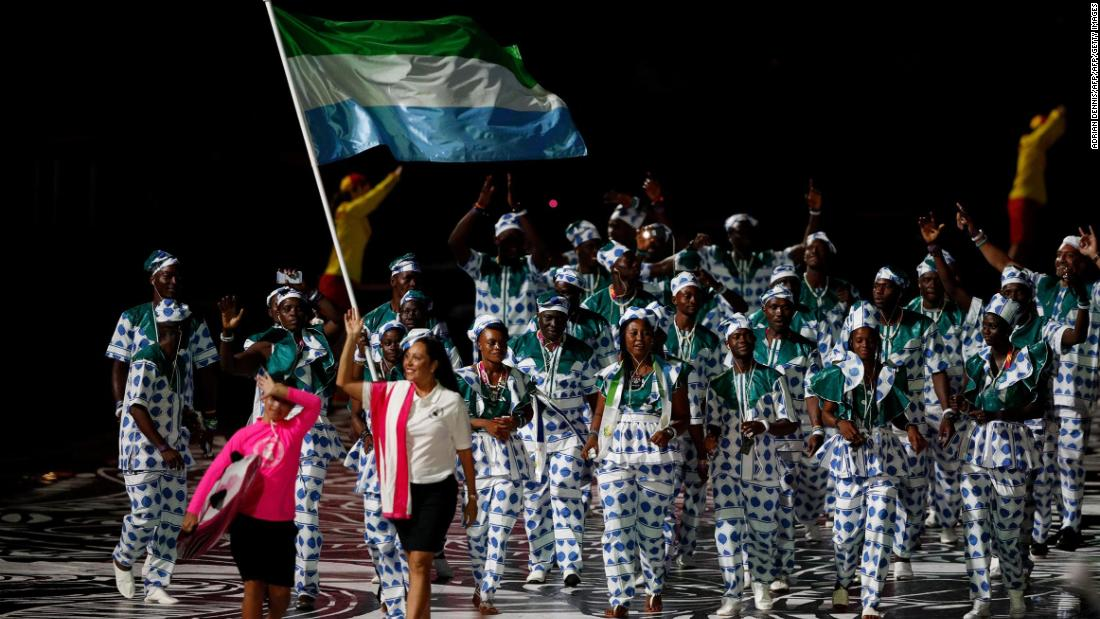 Sierra Leone's flagbearer Hafsatu Kamara leads the delegation during the opening ceremony.
