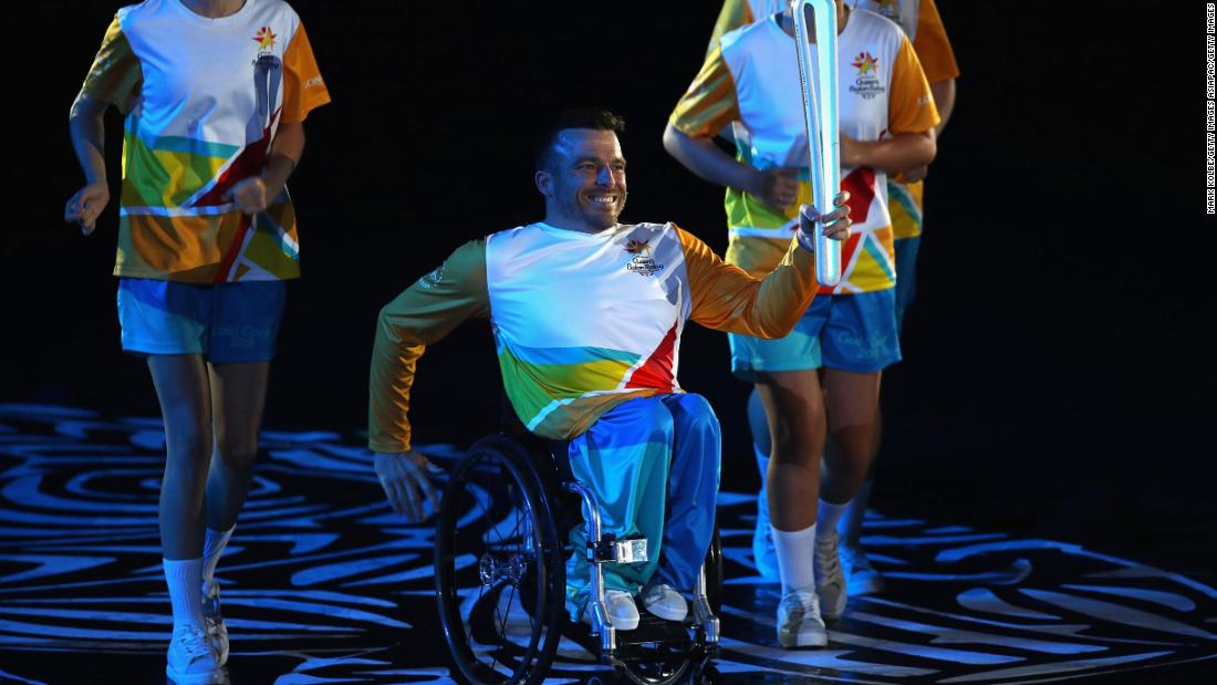 Kurt Fearnley showcases the Queen's Baton, which left Buckingham Palace in March 2017 and traveled for 388 days and 143 thousand miles through the entire Commonwealth.