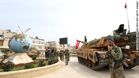 Turkish soldiers and Ankara-backed Syrian Arab fighters spread in the Kurdish-majority city of Afrin in northwestern Syria after seizing control of it from Kurdish People's Protection Units (YPG) on March 18, 2018. Turkish-backed rebels have seized the centre of Afrin city in northern Syria, Ankara said, as they made rapid gains in their campaign against Kurdish forces. A civilian inside Afrin said that rebels had deployed in the city centre and that the YPG militia had withdrawn. / AFP PHOTO / OMAR HAJ KADOUR        (Photo credit should read OMAR HAJ KADOUR/AFP/Getty Images)