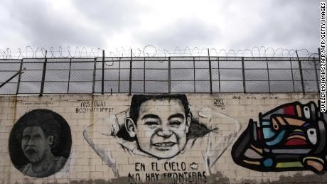 "TOPSHOT - View of murals reading ""In the sky there are no borders"" on the US-Mexico border wall in Tijuana, Baja California, northwestern Mexico on April 2, 2018.  President Donald Trump lashed out Monday at Mexico, Democrats and the US Congress in a furious tirade triggered by images of a ""caravan"" of hundreds of migrants headed for the US border. For the second straight day, Trump took to Twitter to attack Mexico for allowing the group of Central Americans to march unimpeded toward the United States.  / AFP PHOTO / GUILLERMO ARIAS        (Photo credit should read GUILLERMO ARIAS/AFP/Getty Images)"