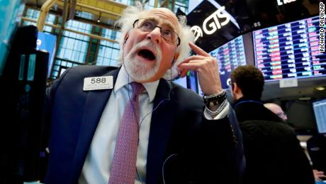 Trader Peter Tuchman works on the floor of the New York Stock Exchange, Wednesday, April 4, 2018. Stocks are opening sharply lower on Wall Street as an escalating trade dispute between the U.S. and China poses a threat to global economic growth and corporate profits. (AP Photo/Richard Drew)